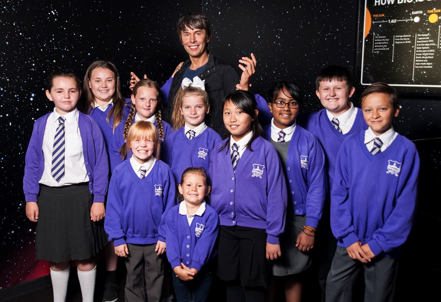 School Children with Brian Cox's wax figure on a school trip to Madame Tussauds Blackpool