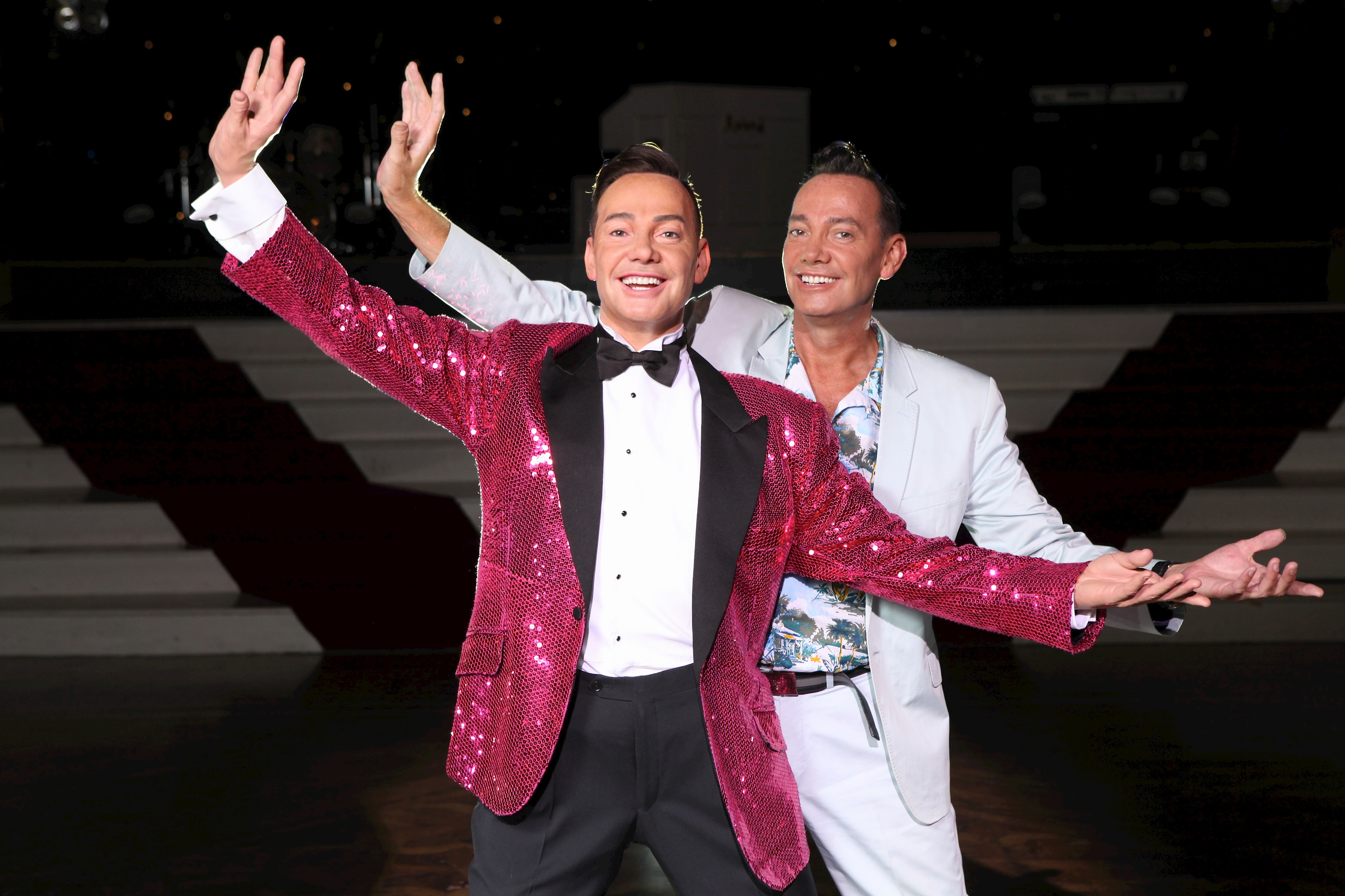 Craig Revel strikes the same dance pose alongside his wax figure at Madame Tussauds Blackpool