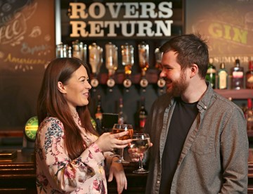 Guests enjoying a drink at the Rovers Return bar in Madame Tussauds Blackpool