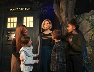 Guests visiting the Dr. Who wax figure at Madame Tussauds Blakcpool