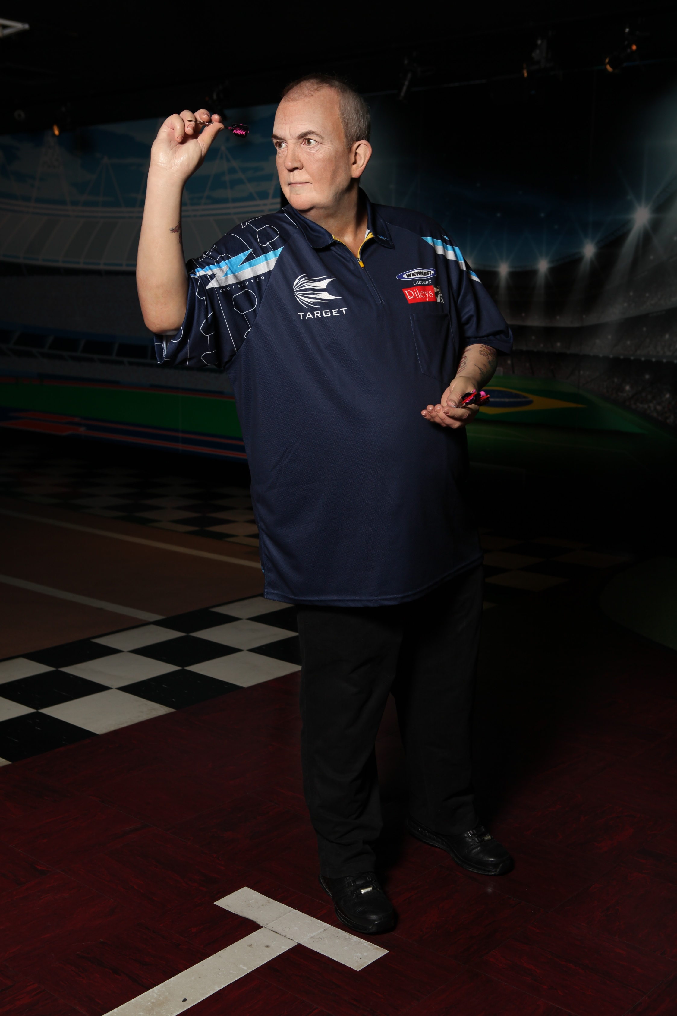 Phil Taylor wax figure throwing a dart at Madame Tussauds Blackpool
