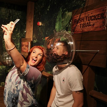 Guests taking a selfie whilst doing the bushtucker trial at Madame Tussauds Blackpool
