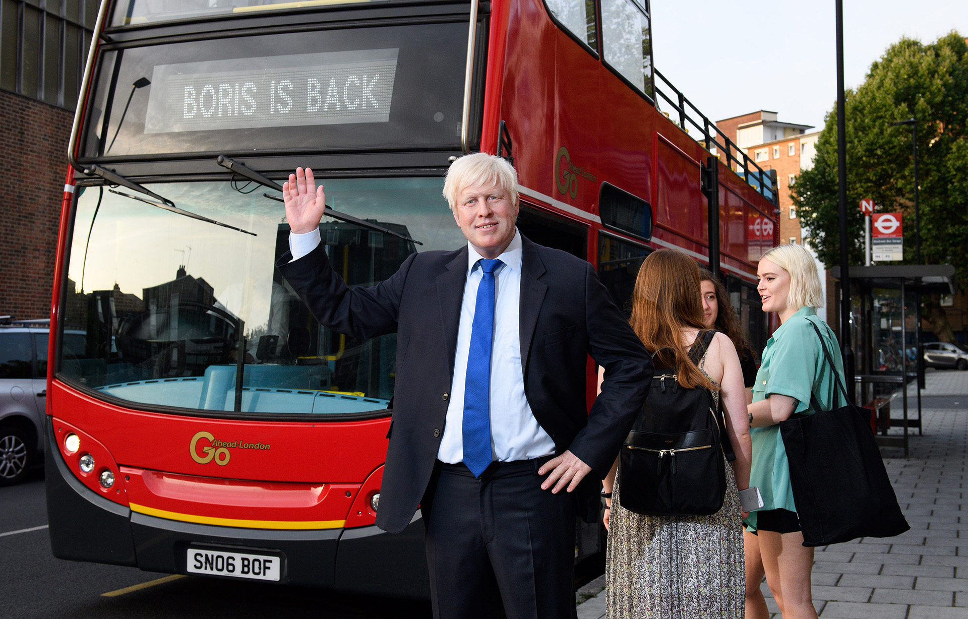 Boris Johnson figure in front of a London Bus