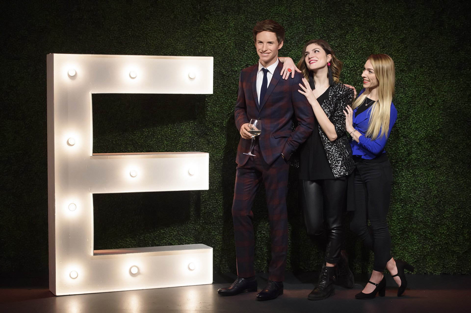 Fans leaning on Eddie Redmayne figure at Madame Tussauds London