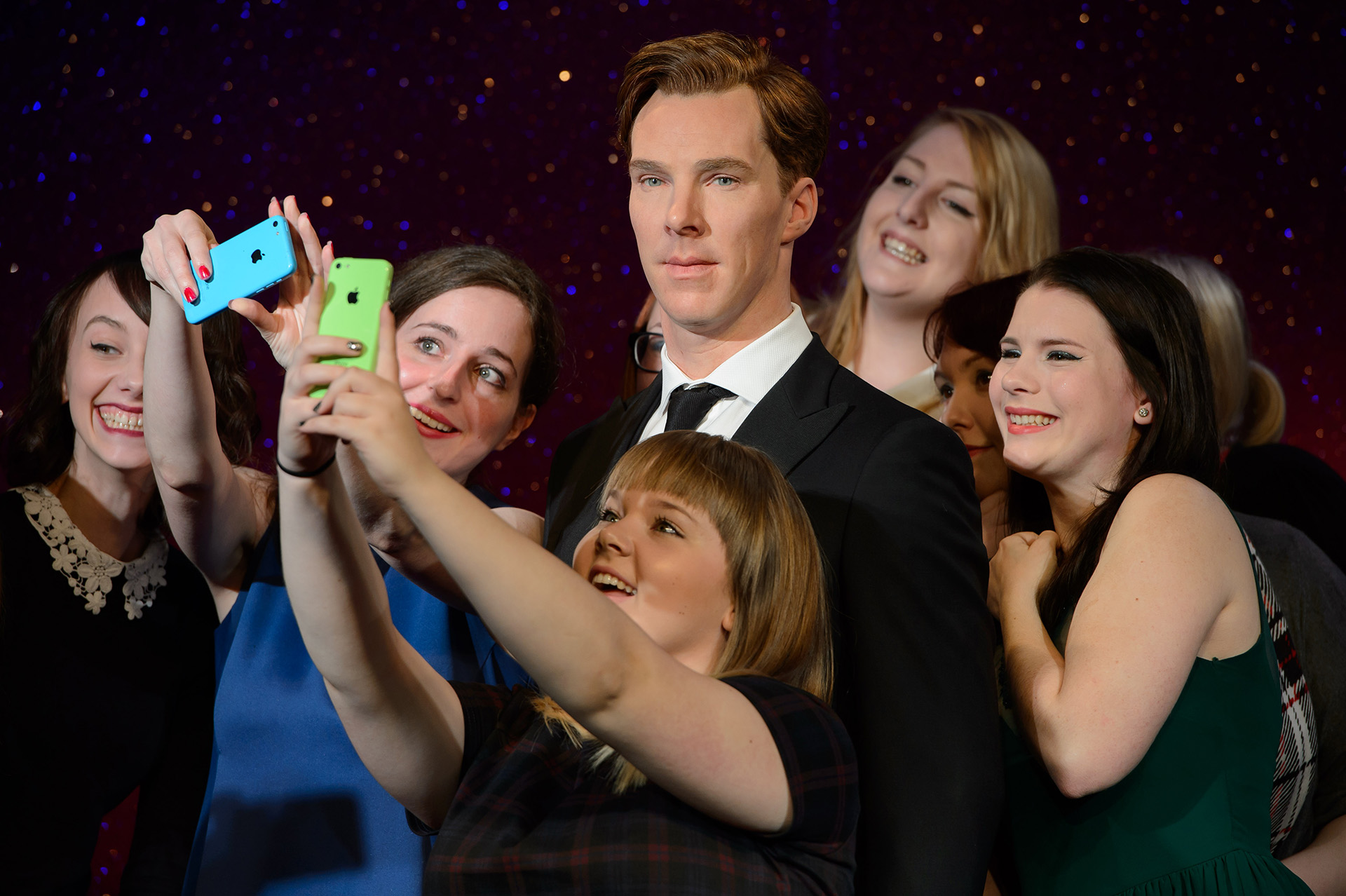 Fans taking a selfie with Benedict Cumberbatch figure at Madame Tussauds