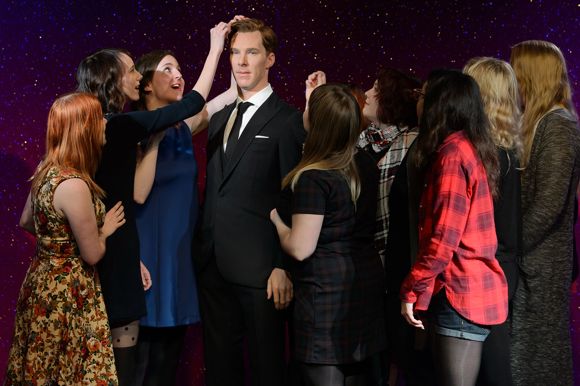Fans interacting with Benedict Cumberbatch figure at Madame Tussauds London