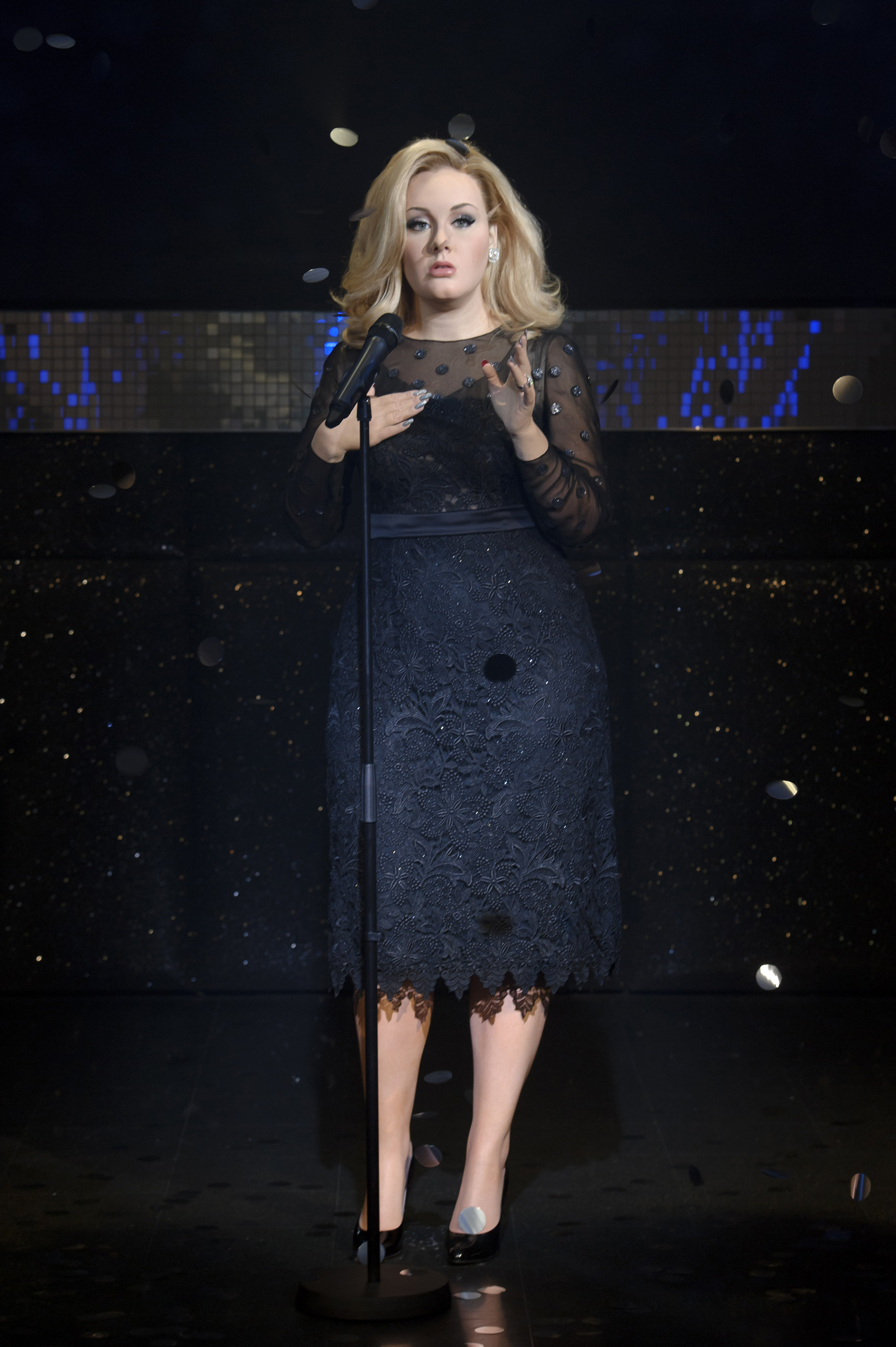Full body view of Adele figure at Madame Tussauds
