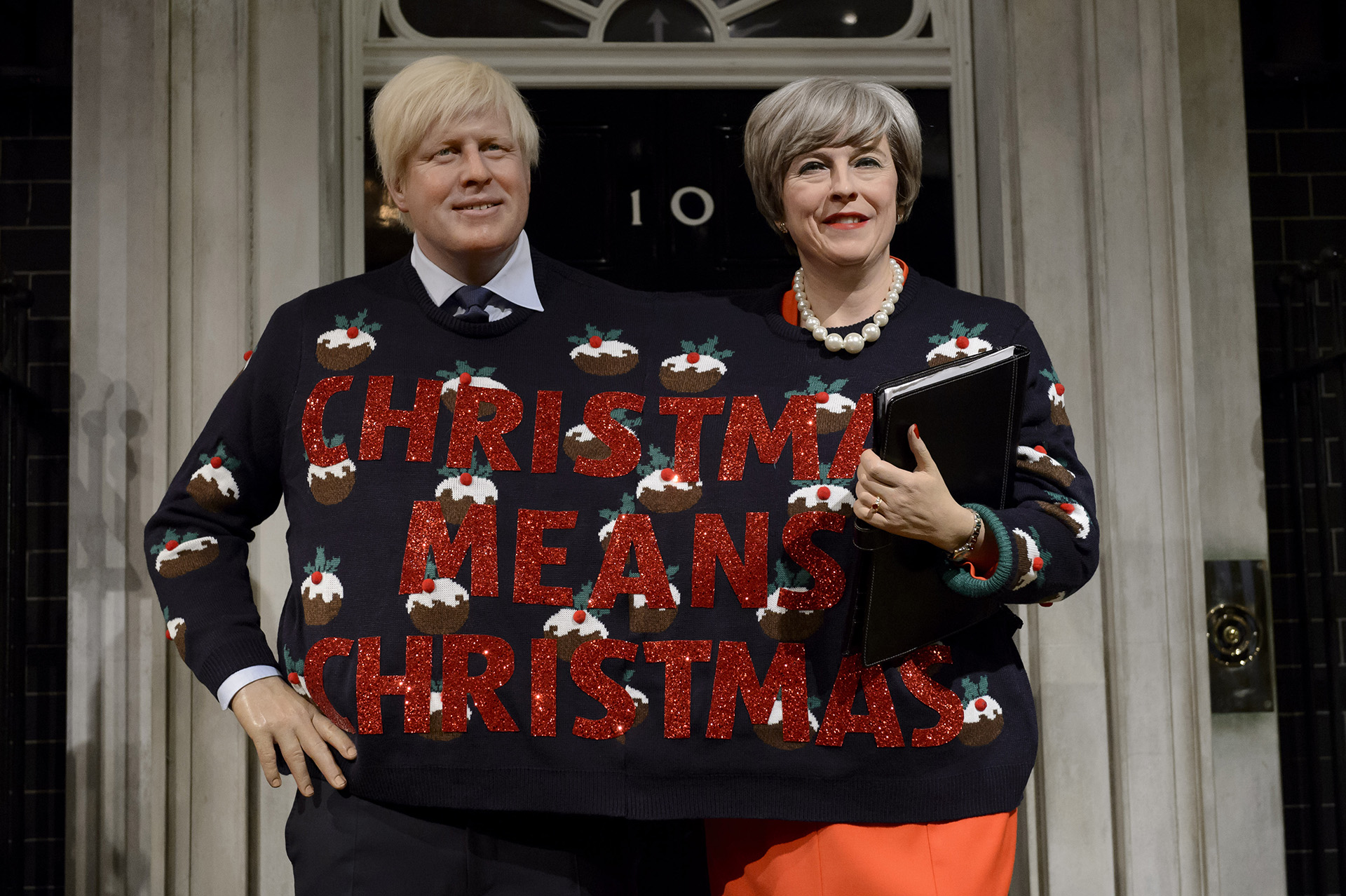 Boris Johnson Theresa May's figures in Christmas Jumper