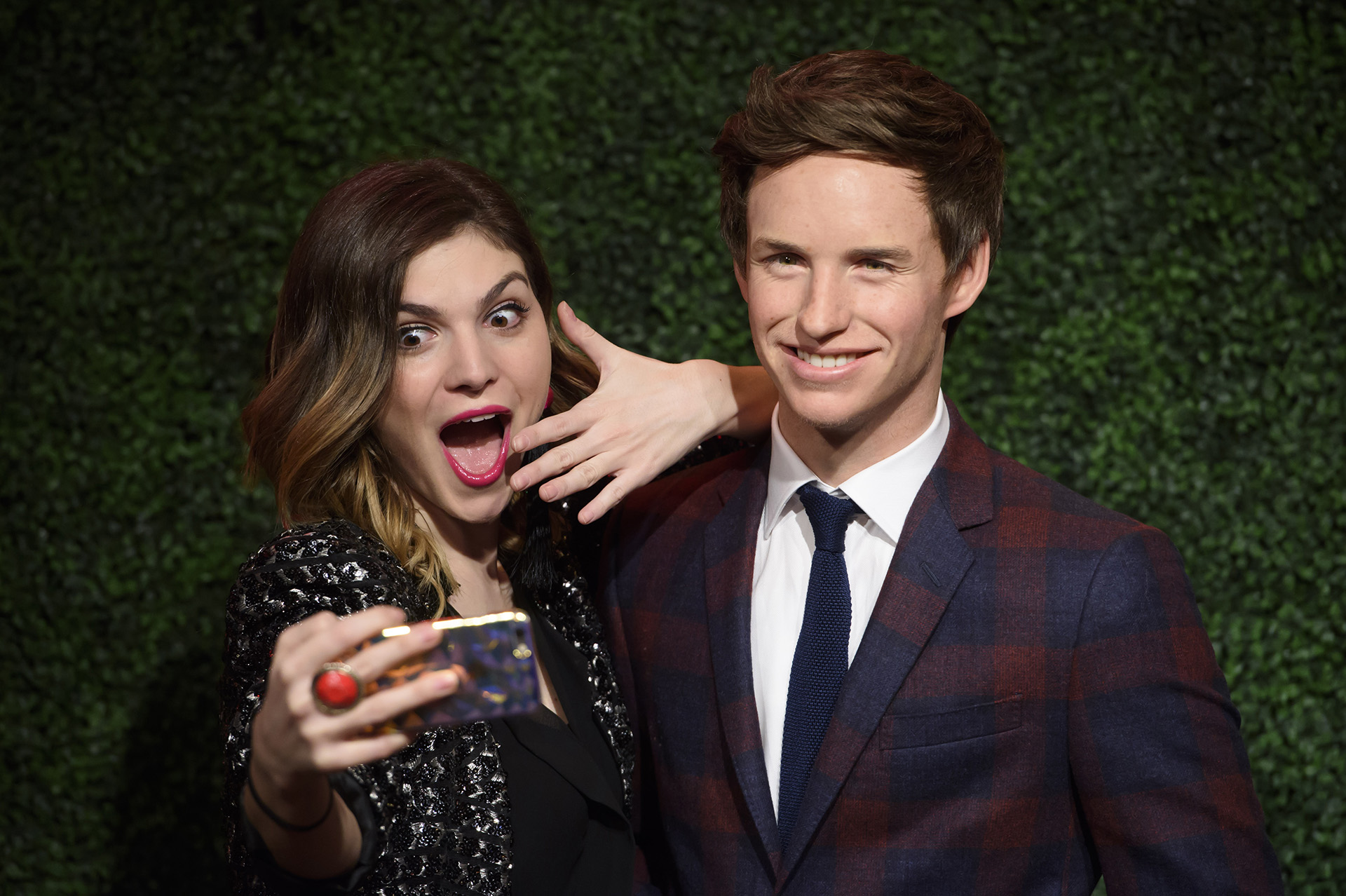 Fan taking a selfie with Eddie Redmayne at Madame Tussauds London