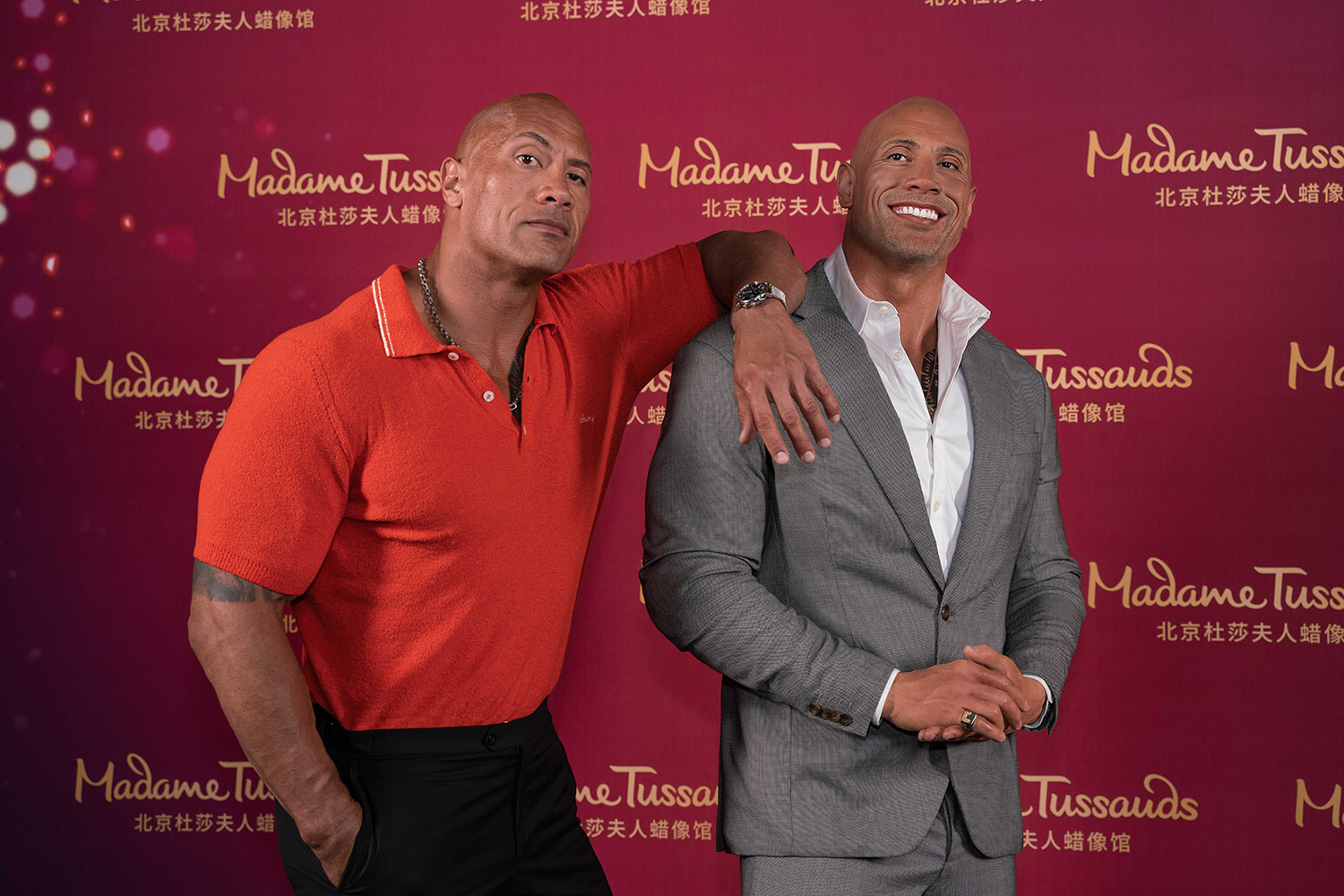 Dwayne Johnson with his figure at Madame Tussauds