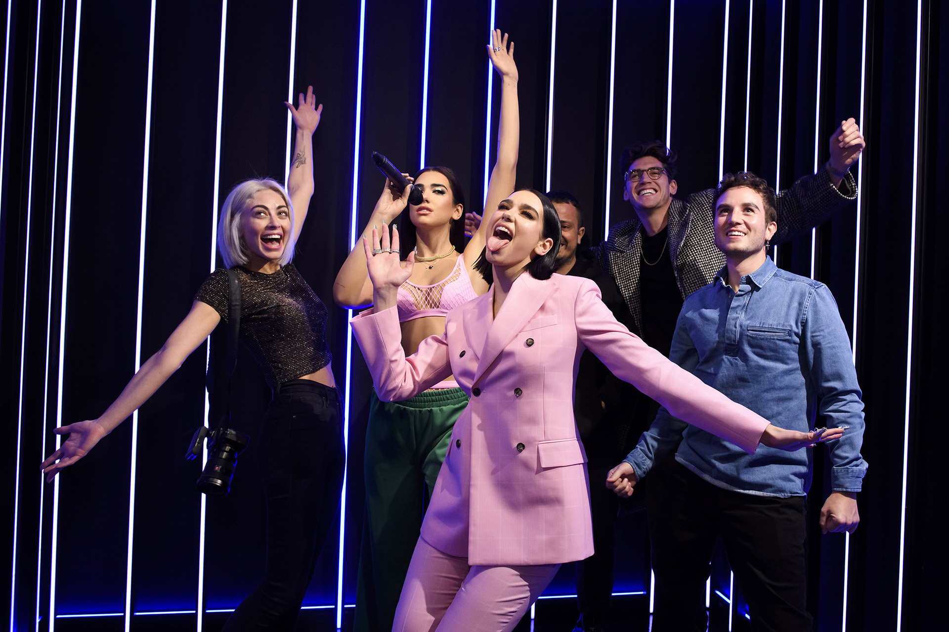 Dua Lipa with her figure and fans at Madame Tussauds