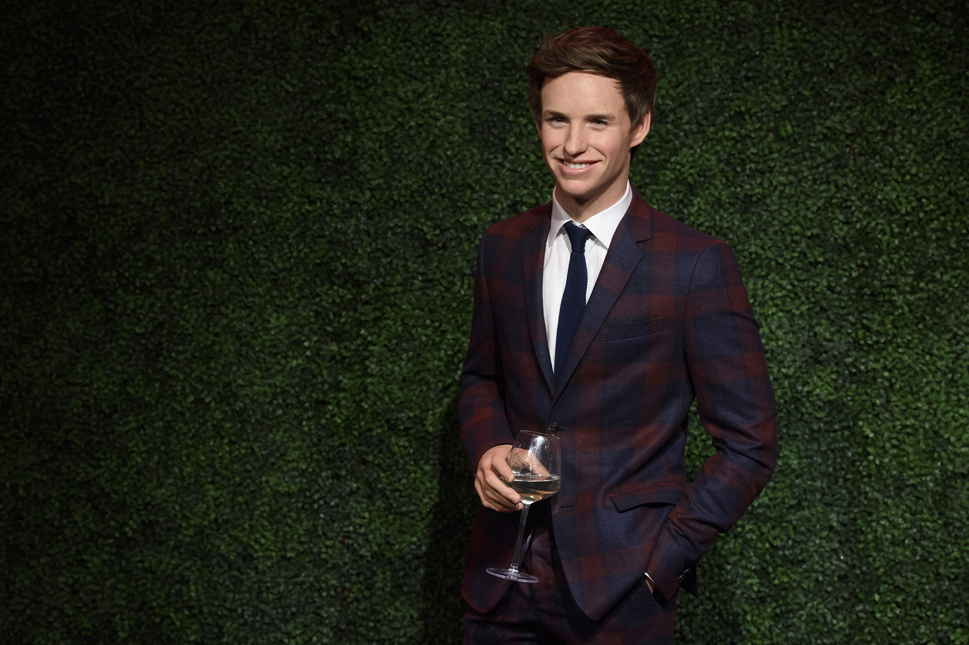 Eddie Redmayne figure holding a glass of wine at Madame Tussauds